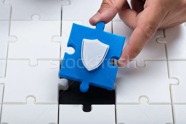 Person connecting last piece into jigsaw puzzles Stock photo © AndreyPopov