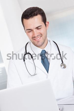 Self-assured doctor with stethoscope Stock photo © AndreyPopov