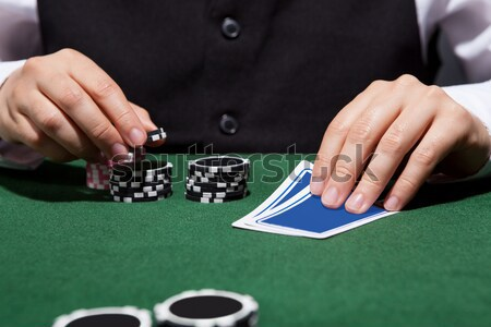 Croupier throwing a pair of dice Stock photo © AndreyPopov