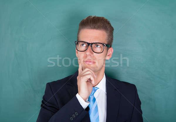 Portret zamyślony mężczyzna profesor wykładowca stałego Zdjęcia stock © AndreyPopov