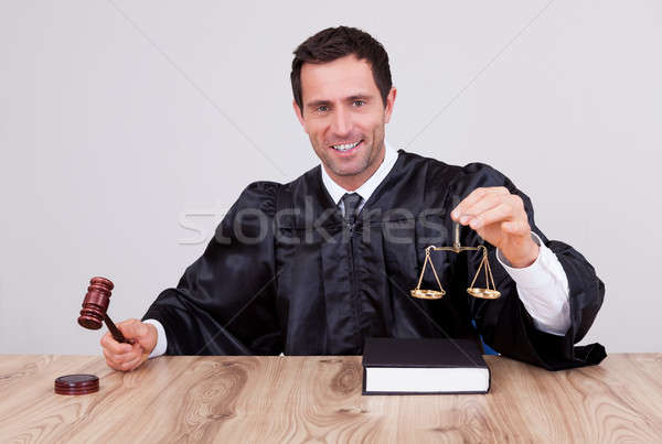 Male Judge Holding Scale Stock photo © AndreyPopov