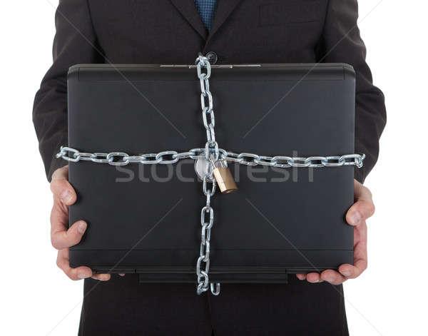 Empresário laptop cadeia trancar isolado Foto stock © AndreyPopov