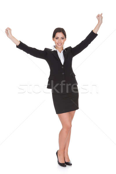 Businesswoman Celebrating With Hand Raised Stock photo © AndreyPopov