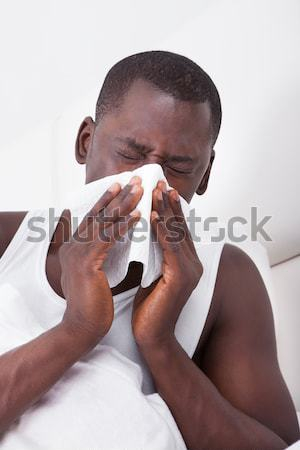 Man with a cold blowing his nose Stock photo © AndreyPopov