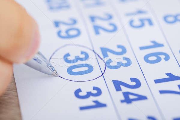 Businessman Marking Date On Calendar At Desk Stock photo © AndreyPopov