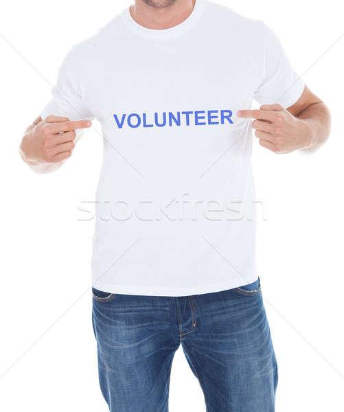Man Pointing At His Volunteer Tshirt Stock photo © AndreyPopov