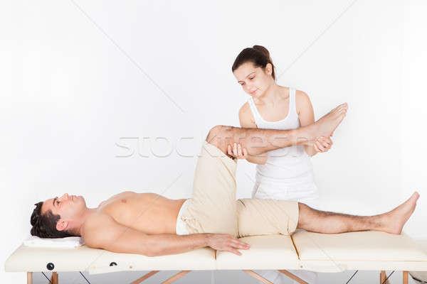 Vrouw voet jonge man tabel massage Stockfoto © AndreyPopov