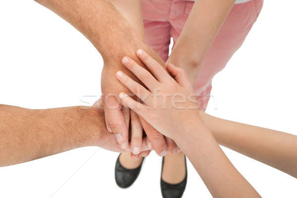 Cropped Image Of Family Stacking Hands Stock photo © AndreyPopov