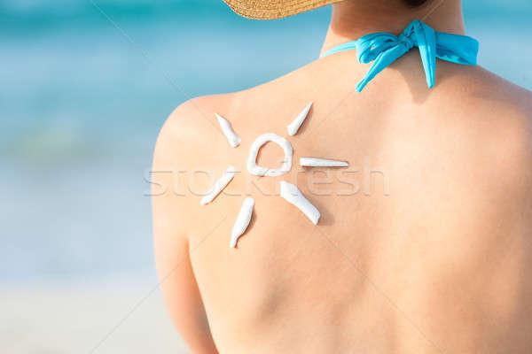 Donna sole protezione solare indietro vista posteriore Foto d'archivio © AndreyPopov