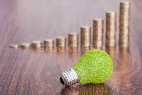 Stack Of Coins With Ecological Bulb Stock photo © AndreyPopov
