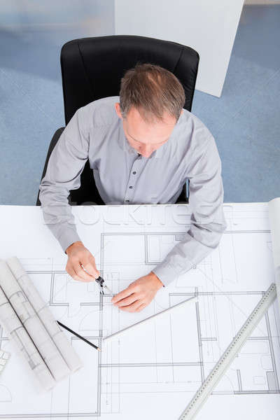 Architect Drawing On Blueprint Stock photo © AndreyPopov