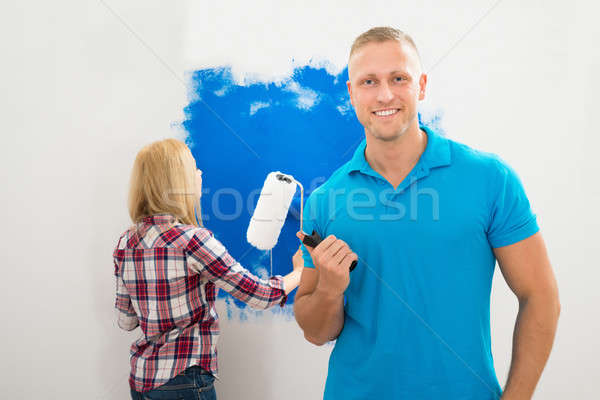 Young Man Holding Paint Roller Stock photo © AndreyPopov