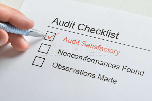 Stock photo: Person Hand Making Tick In Audit Checklist
