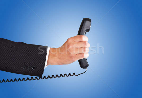 Businessman's Hand Holding Telephone Receiver Stock photo © AndreyPopov