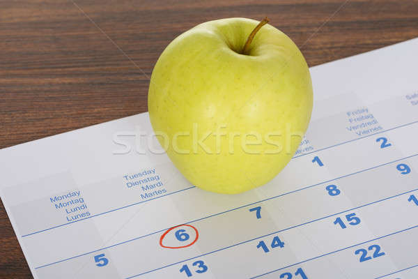 Apple On Calendar Marked With Marker Stock photo © AndreyPopov