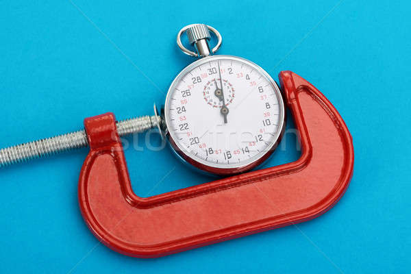 Adjustable Clamp And Stopwatch Stock photo © AndreyPopov