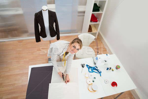 Happy Fashion Designer In Studio Stock photo © AndreyPopov