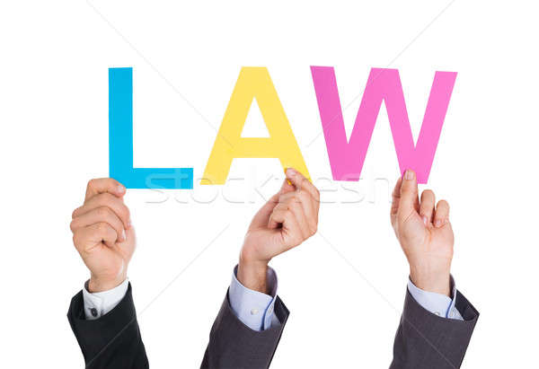 Businesspeople Hands Holding Word Law Stock photo © AndreyPopov