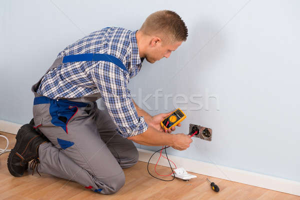 Electrician Checking Voltage With Multimeter Stock photo © AndreyPopov