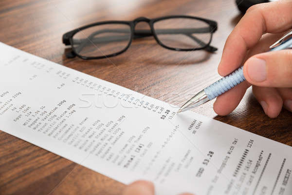 Businessperson Hands With Receipt And Eyeglasses Stock photo © AndreyPopov