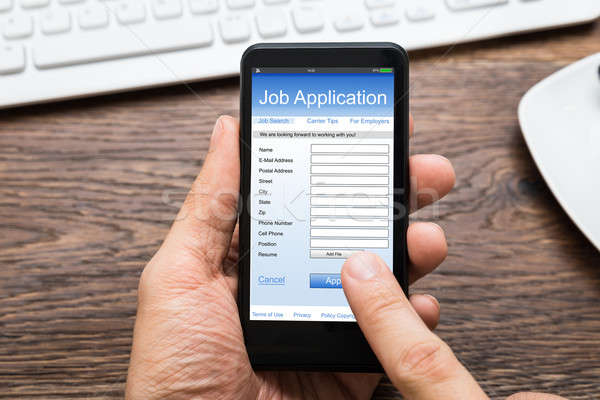 Person Hands Filling Job Application On Mobile Phone Stock photo © AndreyPopov