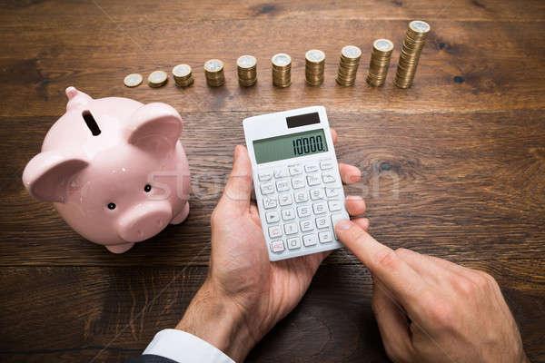 Empresario monedas calculadora escritorio Foto stock © AndreyPopov