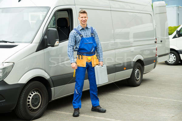 Repairman With Tools And Toolbox In Front Of Van Stock photo © AndreyPopov