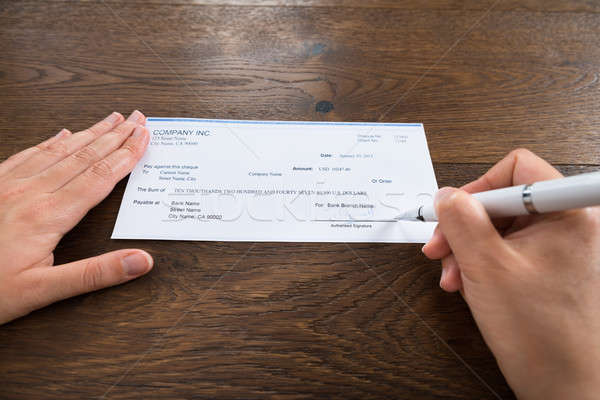 Person Hands Signing Cheque With Pen Stock photo © AndreyPopov