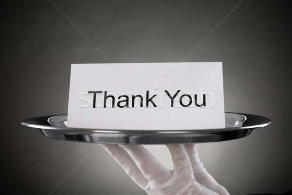 Waiter Holding Plate With The Text Thank You On Paper Stock photo © AndreyPopov