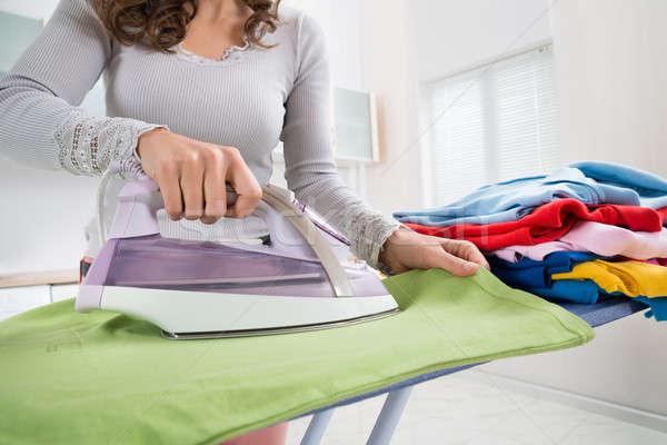 Female Hands Ironing T-shirt Stock photo © AndreyPopov