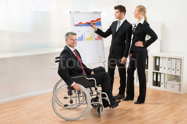 Businessman Explaining Graph To His Team Stock photo © AndreyPopov