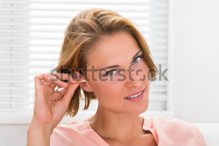 Woman Cleaning Ear Stock photo © AndreyPopov