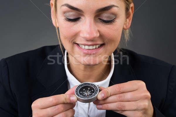 üzletasszony tart iránytű szürke közelkép fiatal Stock fotó © AndreyPopov