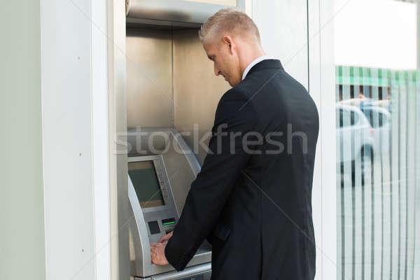 若い男 気圧 マシン お金 紙 手 ストックフォト © AndreyPopov