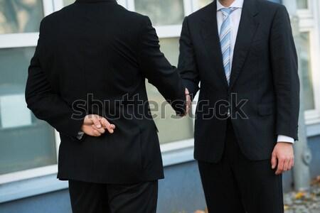Empresário dólares aperto de mãos parceiro desonesto Foto stock © AndreyPopov