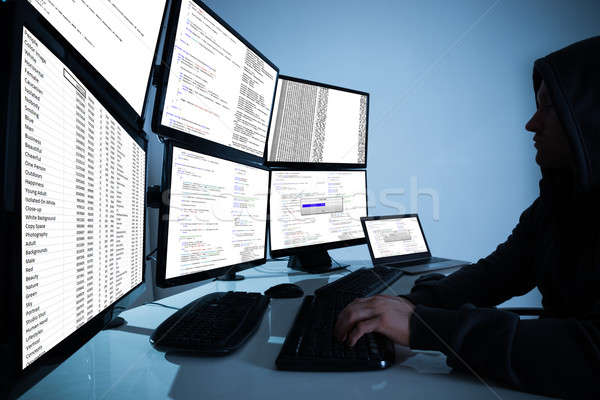 Hacker Using Computers To Steal Data Stock photo © AndreyPopov