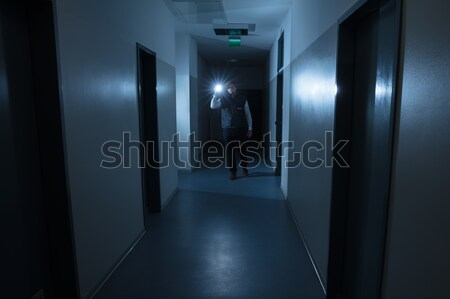 Security Guard With Flashlight Standing In Front Of Door Stock photo © AndreyPopov