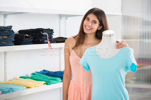 Smiling Woman Standing By Mannequin Displaying Top In Store Stock photo © AndreyPopov