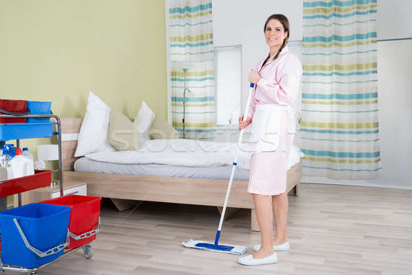 Female Housekeeper Mopping Floor Stock photo © AndreyPopov