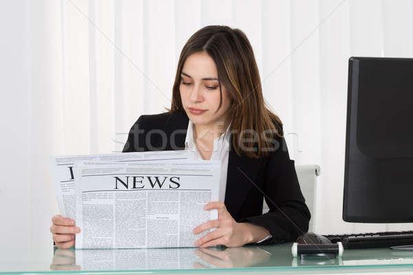 Stock photo: Businesswoman Reading Newspaper