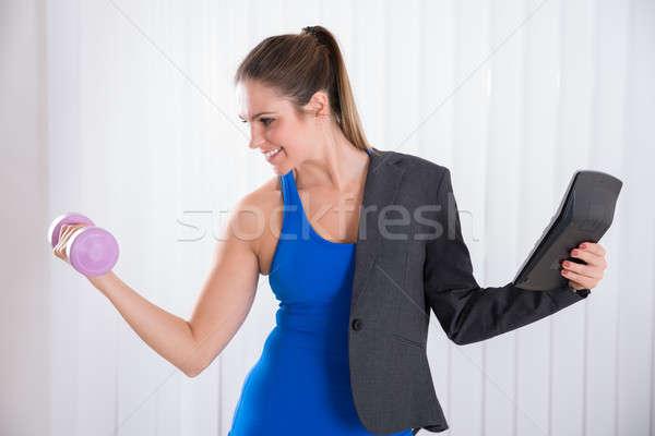 Donna multipla lavoro giovani felice multitasking Foto d'archivio © AndreyPopov