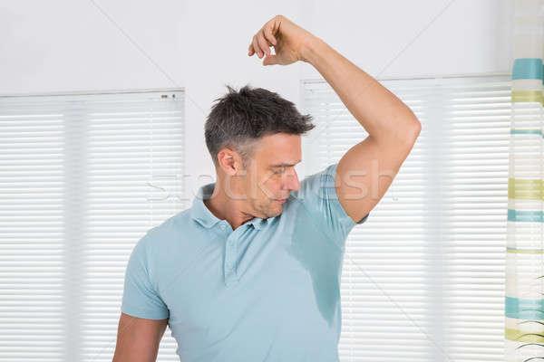 Férfi izzadság érett férfi hónalj otthon férfiak Stock fotó © AndreyPopov