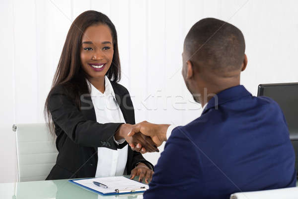 Two Businesspeople Shaking Hands At Office Stock photo © AndreyPopov