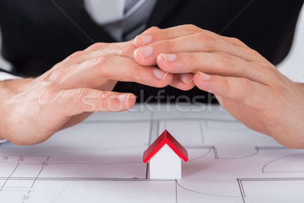 Male Architect Hand Sheltering House Model Stock photo © AndreyPopov