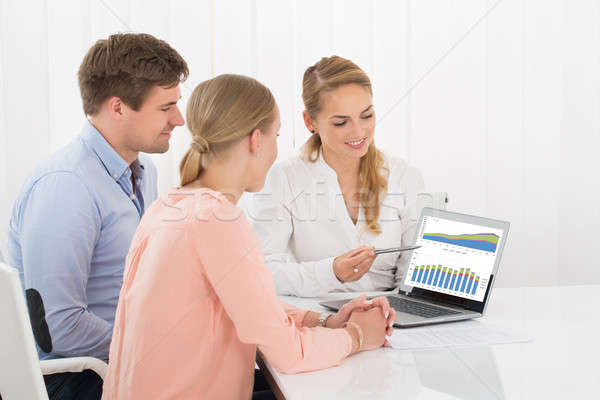 Financial Advisor Showing Chart To Couple Stock photo © AndreyPopov