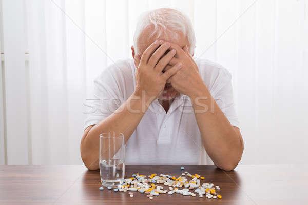 Depressief senior man pillen bureau medische Stockfoto © AndreyPopov