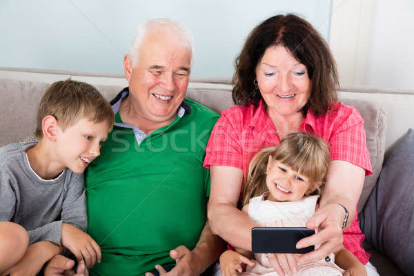Happy Multi Generation Family Taking Picture At Home Stock photo © AndreyPopov