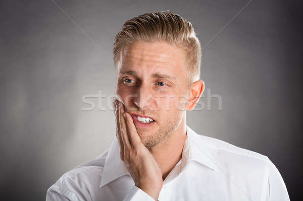 Young Man Suffering From Tooth Ache  Stock photo © AndreyPopov