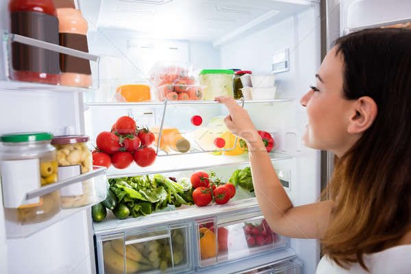 Woman Searching For Food In The Fridge Stock photo © AndreyPopov