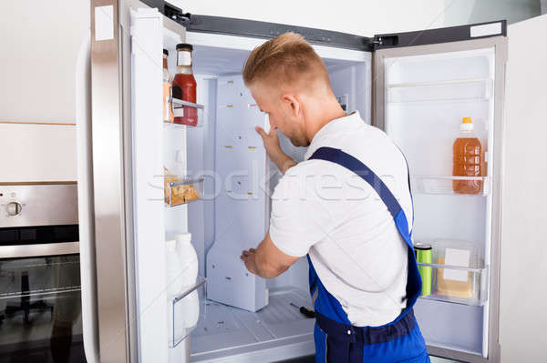 Repairman Fixing Refrigerator Stock photo © AndreyPopov